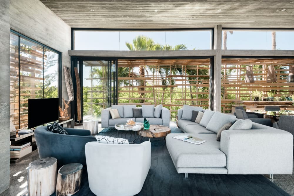 """The open living area of Villa Islander, which huge windows on all sides.<span class=""""sr-only""""> (opened in a new window/tab)</span>"""