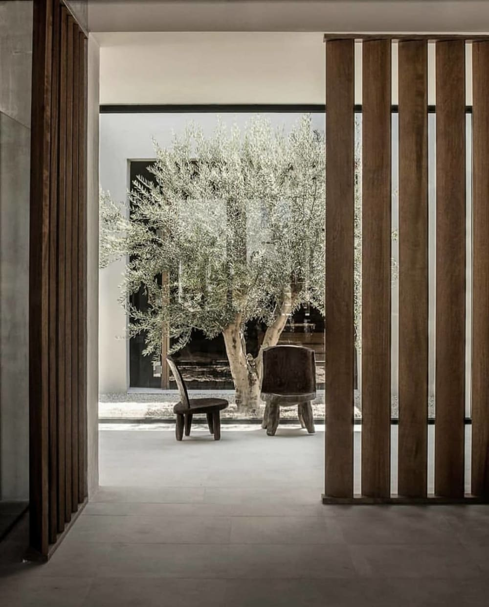 """Biophilic outdoor space with a rustic vibe: clean wood panelling with organic chairs.<span class=""""sr-only""""> (opened in a new window/tab)</span>"""