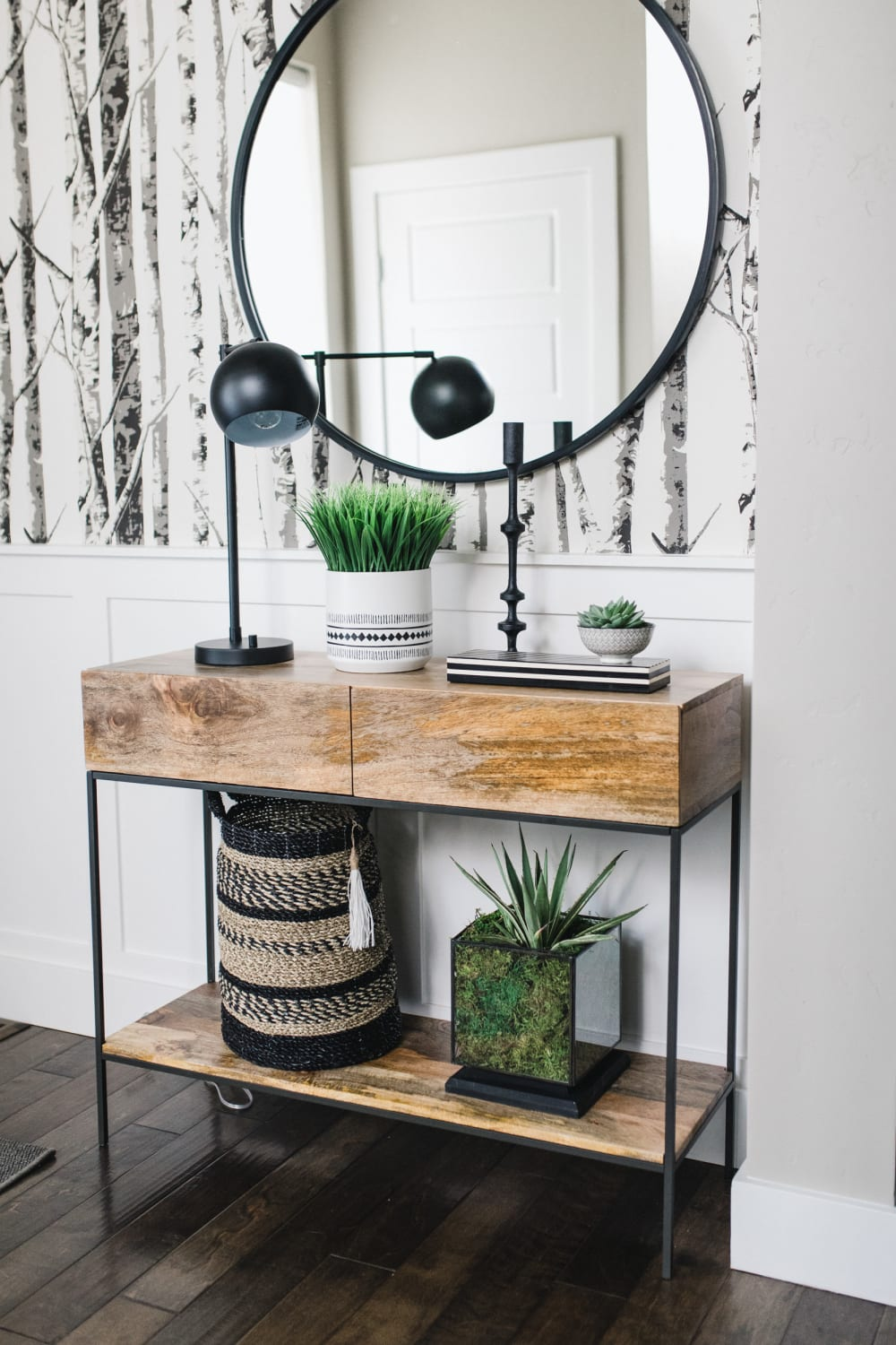 """Biophilic entryway with greenery, natural materials and a wallpaper depicting trees in a forest.<span class=""""sr-only""""> (opened in a new window/tab)</span>"""