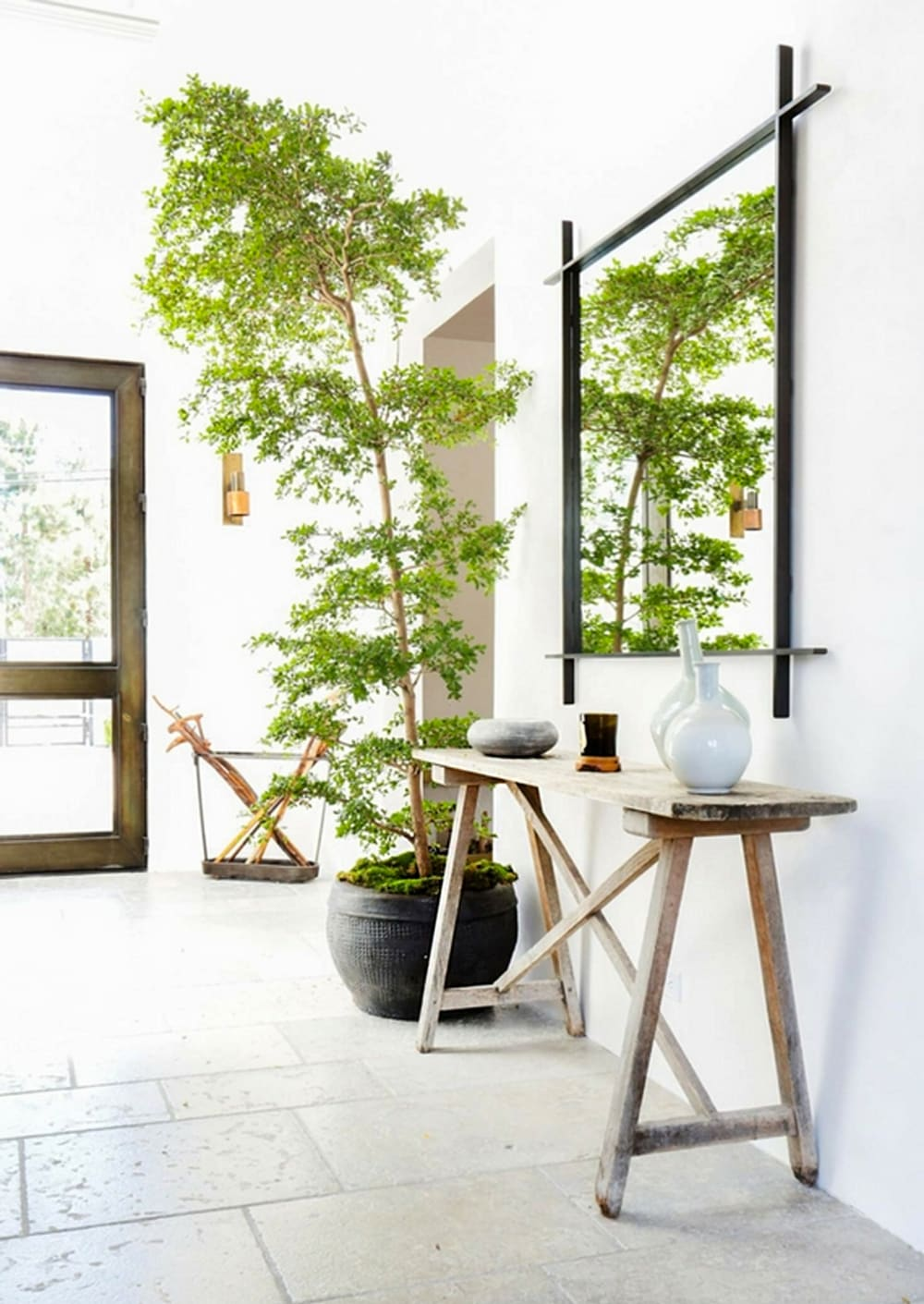 """Airy rustic entryway with an oversized plant.<span class=""""sr-only""""> (opened in a new window/tab)</span>"""
