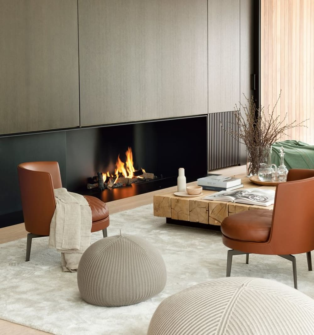 """Living room with earthy palette and fireplace.<span class=""""sr-only""""> (opened in a new window/tab)</span>"""