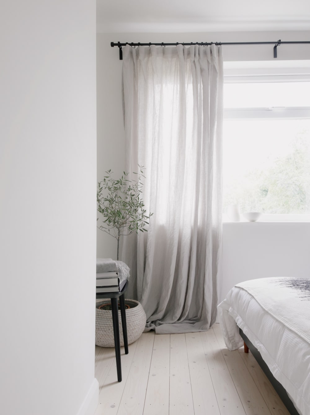 "Total-white bedroom with curtains moving in the breeze.<span class=""sr-only""> (opened in a new window/tab)</span>"