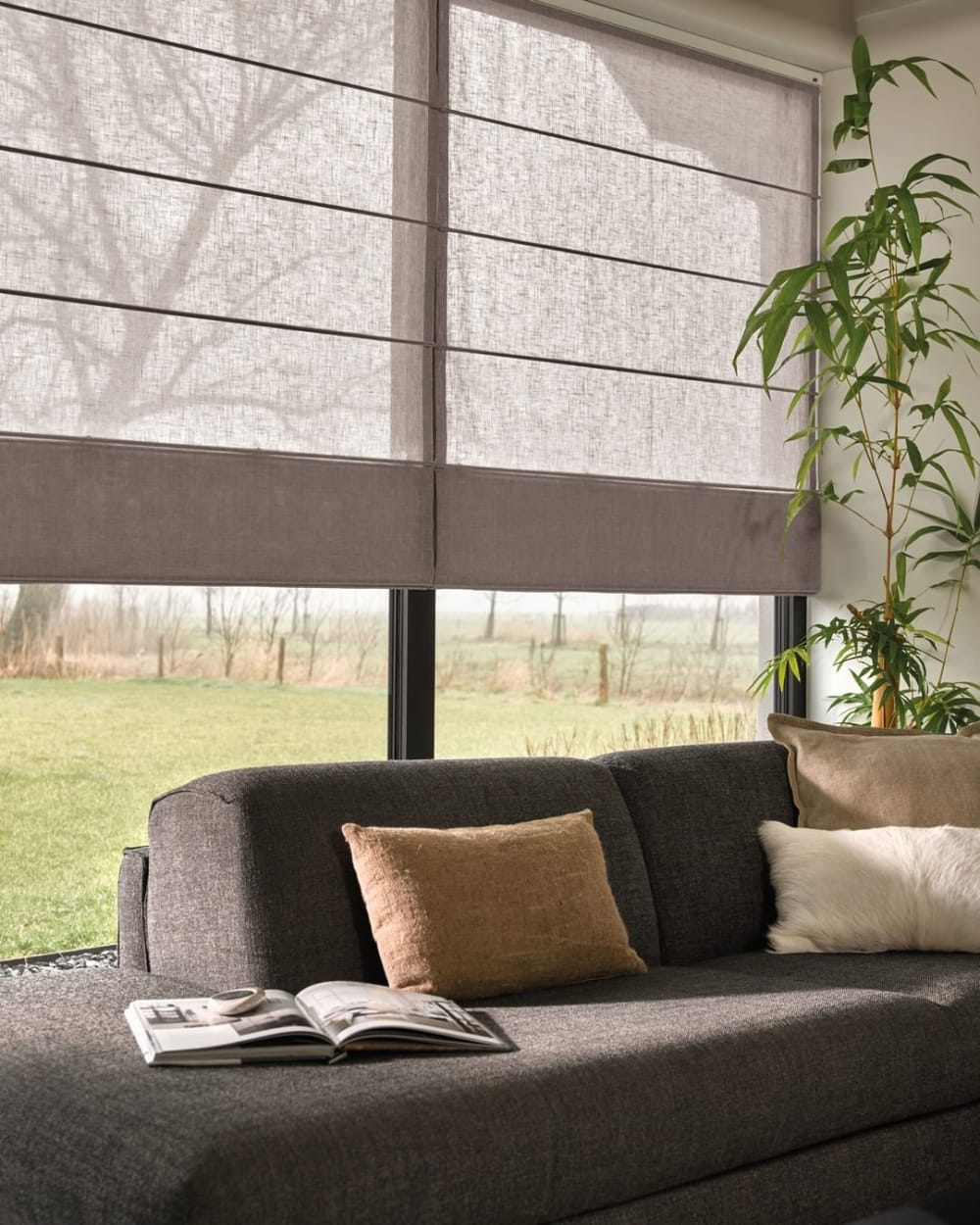 "Roman blinds creating shadow on a sofa area.<span class=""sr-only""> (opened in a new window/tab)</span>"