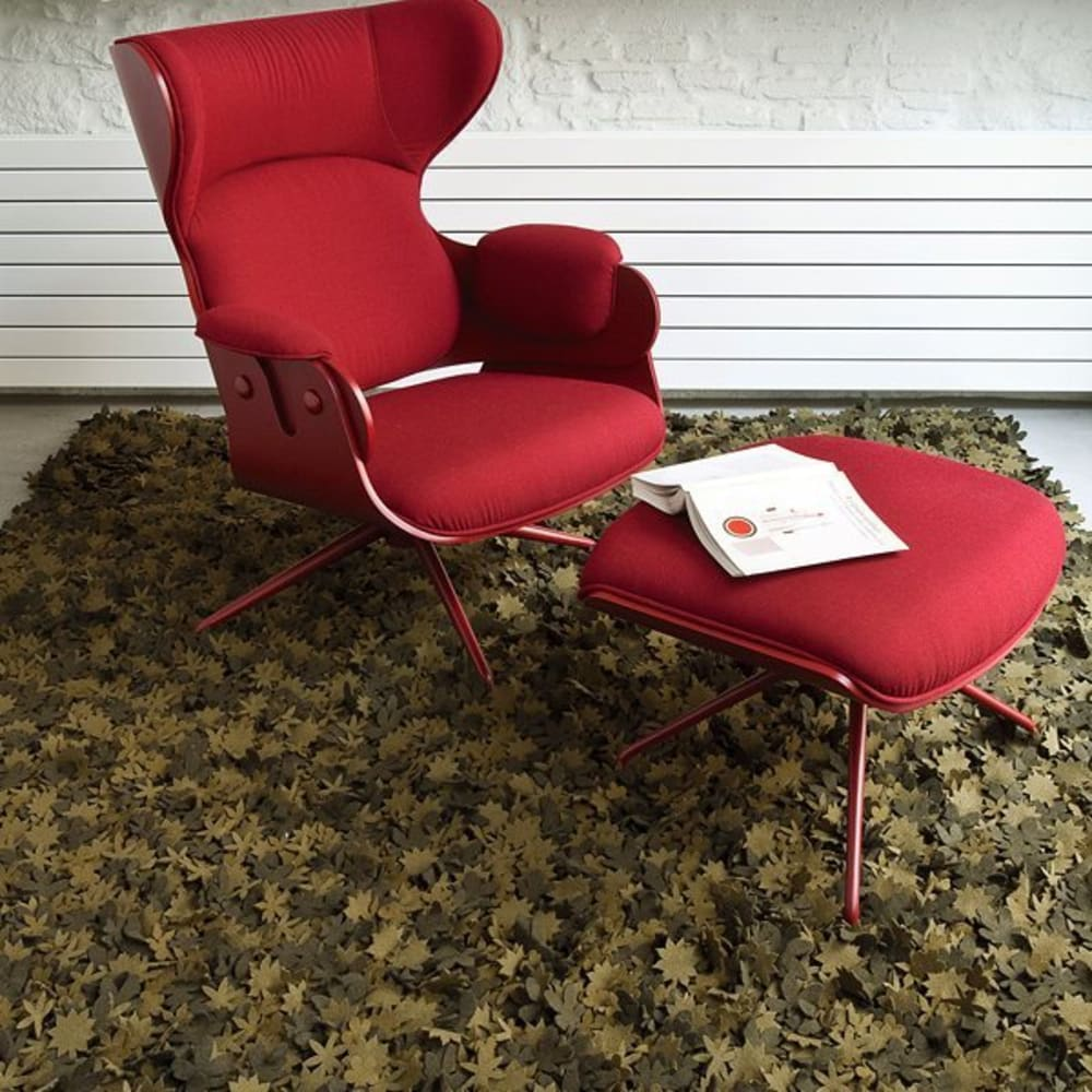 "Red armchair on a rug made with little individual wood felt flowers.<span class=""sr-only""> (opened in a new window/tab)</span>"