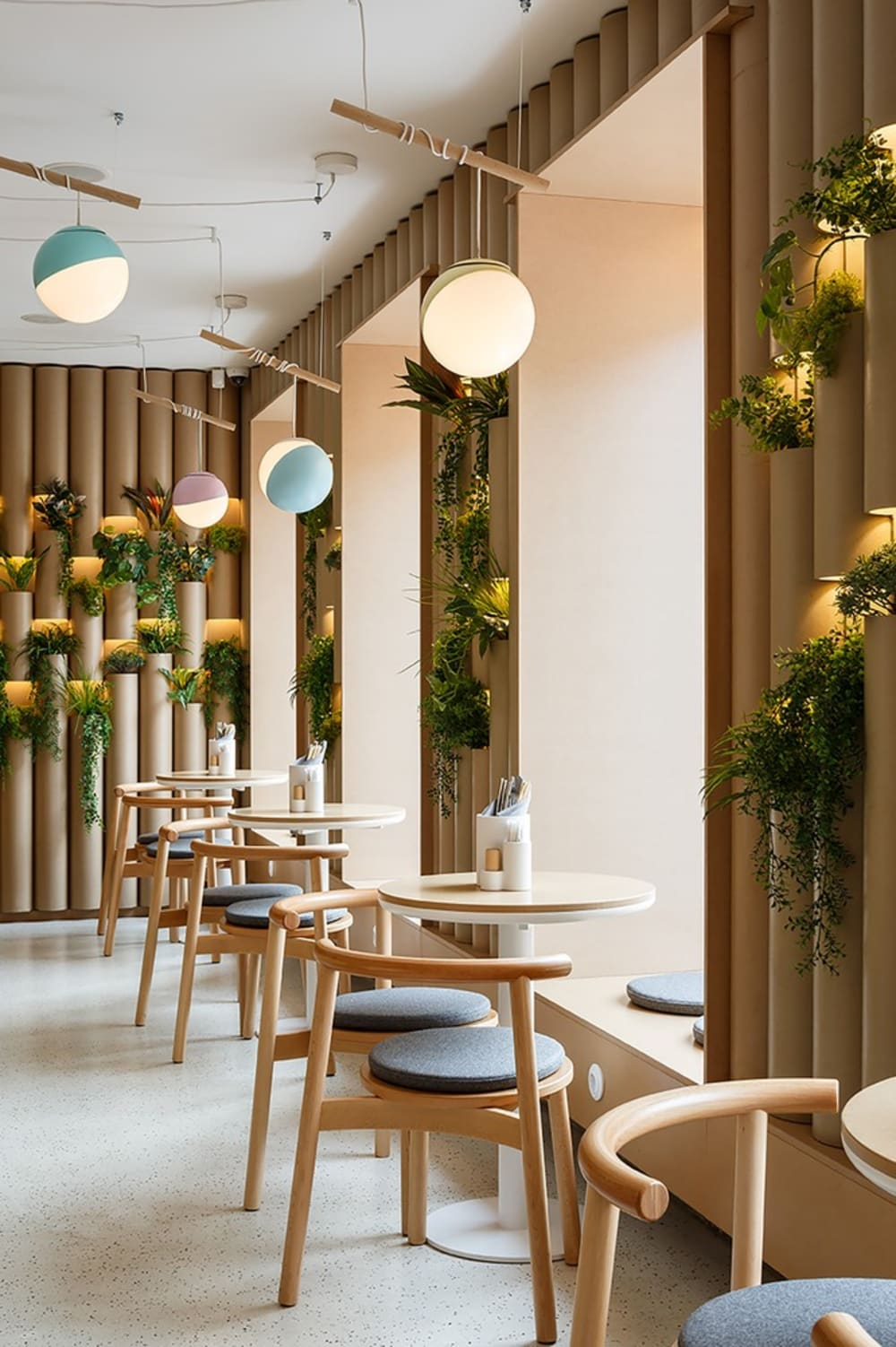 "Contemporary restaurant with plants draping from the cane-looking wall treatment.<span class=""sr-only""> (opened in a new window/tab)</span>"