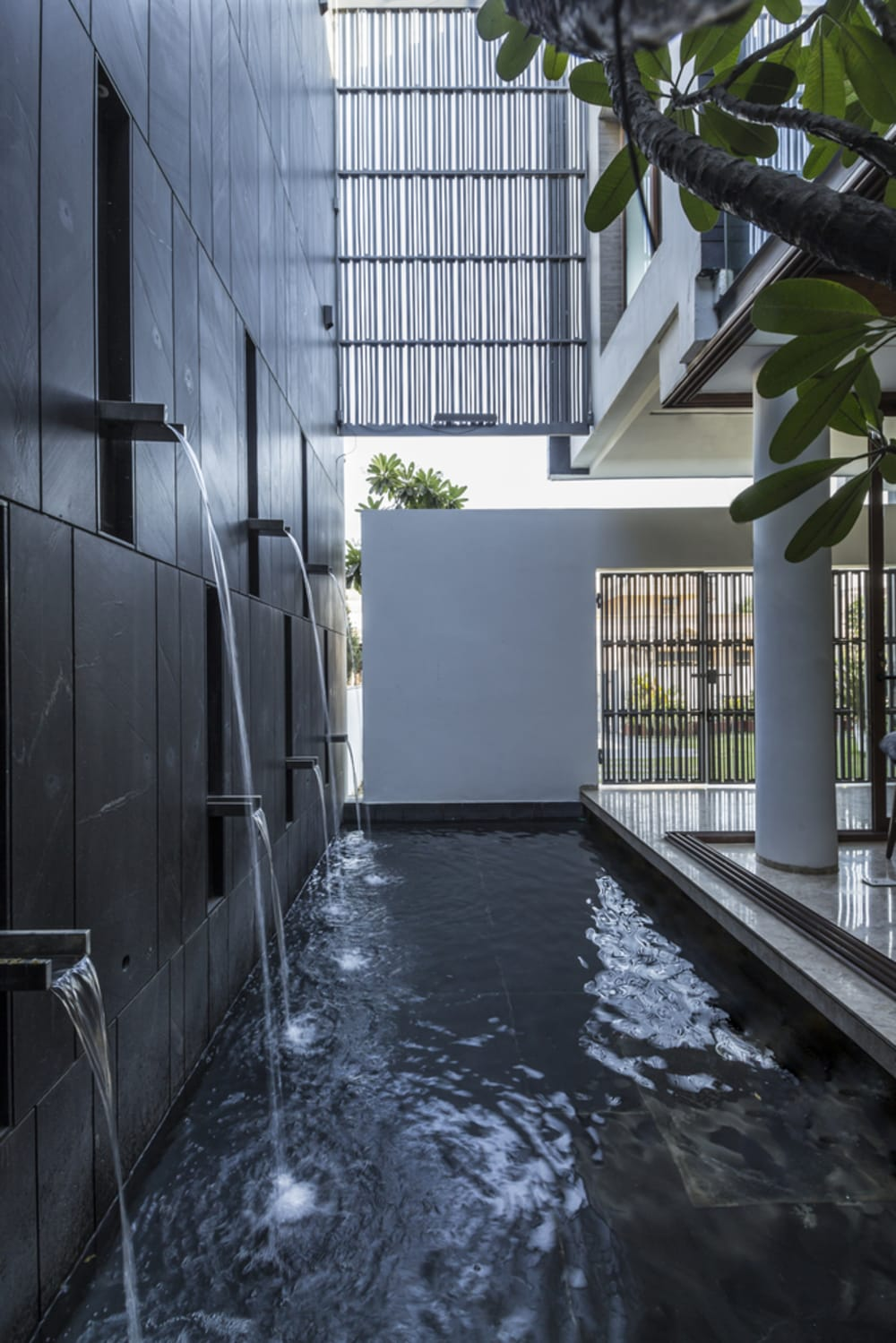 "Black stone wall with water fountains at different heights.<span class=""sr-only""> (opened in a new window/tab)</span>"