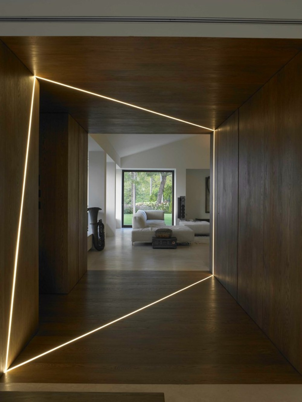 """Dark corridor with a light strip recessed into the wall & ceiling which creates an interesting shape.<span class=""""sr-only""""> (opened in a new window/tab)</span>"""
