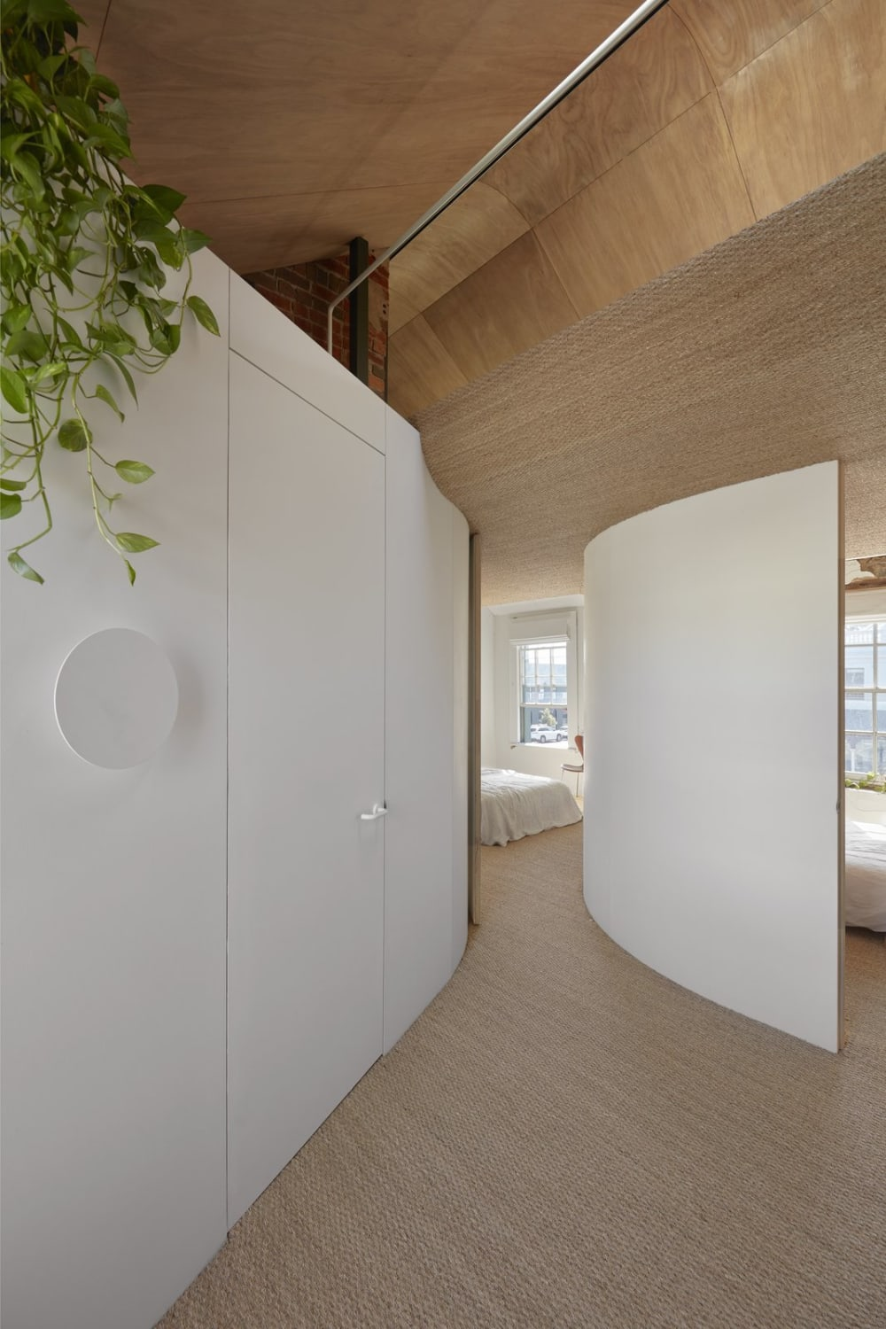 """Bedroom with curved walls.<span class=""""sr-only""""> (opened in a new window/tab)</span>"""
