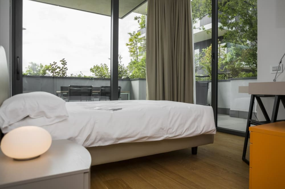 "Bedroom in the Bosco verticale with view on the greenery.<span class=""sr-only""> (opened in a new window/tab)</span>"