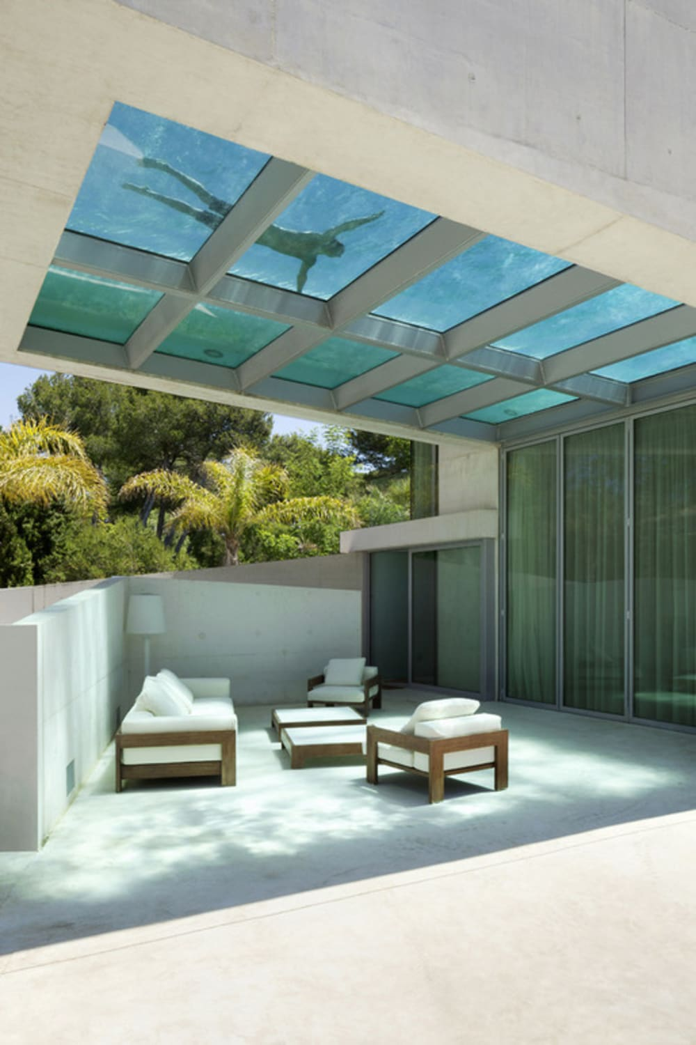 """Pool with a glass bottom located over a seating area.<span class=""""sr-only""""> (opened in a new window/tab)</span>"""