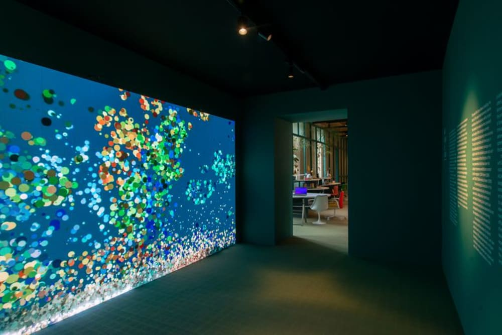 """An interactive wall translating passing people into moving dots.<span class=""""sr-only""""> (opened in a new window/tab)</span>"""