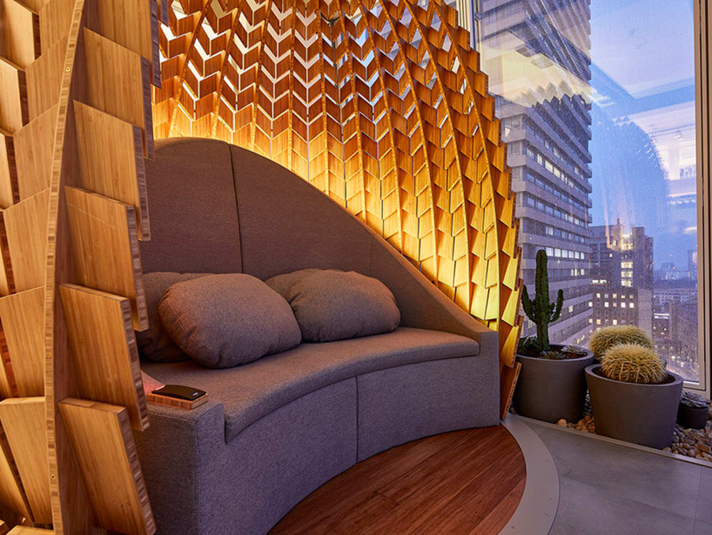"""Close-up of the indoor of a wooden retreat pod with a shape that recalls a pinecone.<span class=""""sr-only""""> (opened in a new window/tab)</span>"""