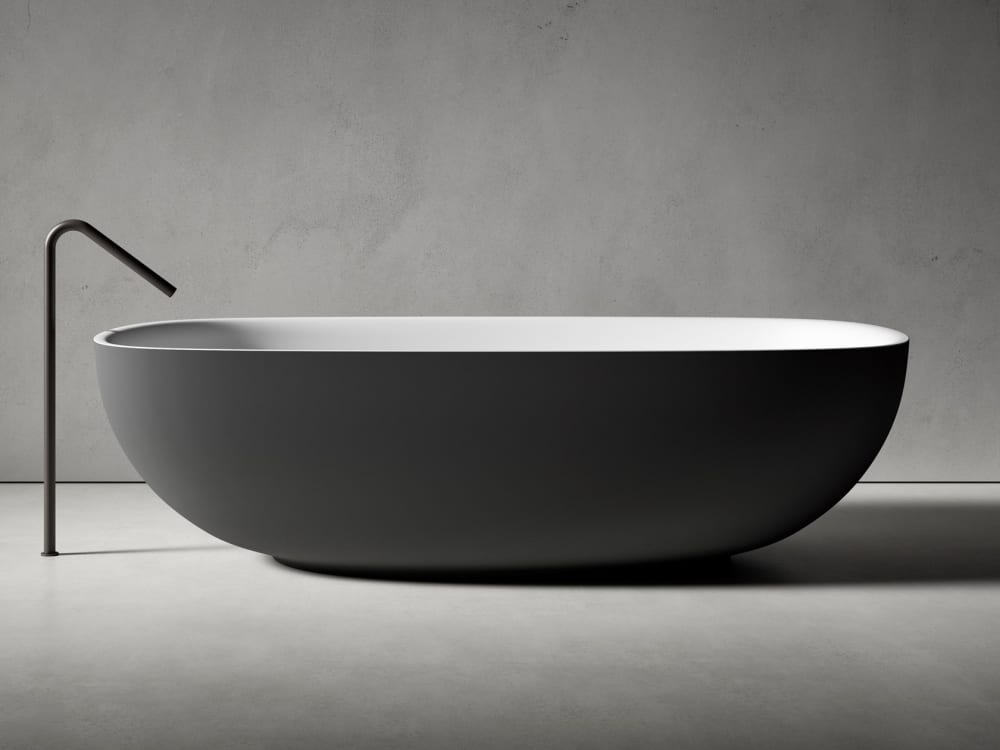 "Bathtub with an oval shape and rounded floor-mounted faucet.<span class=""sr-only""> (opened in a new window/tab)</span>"
