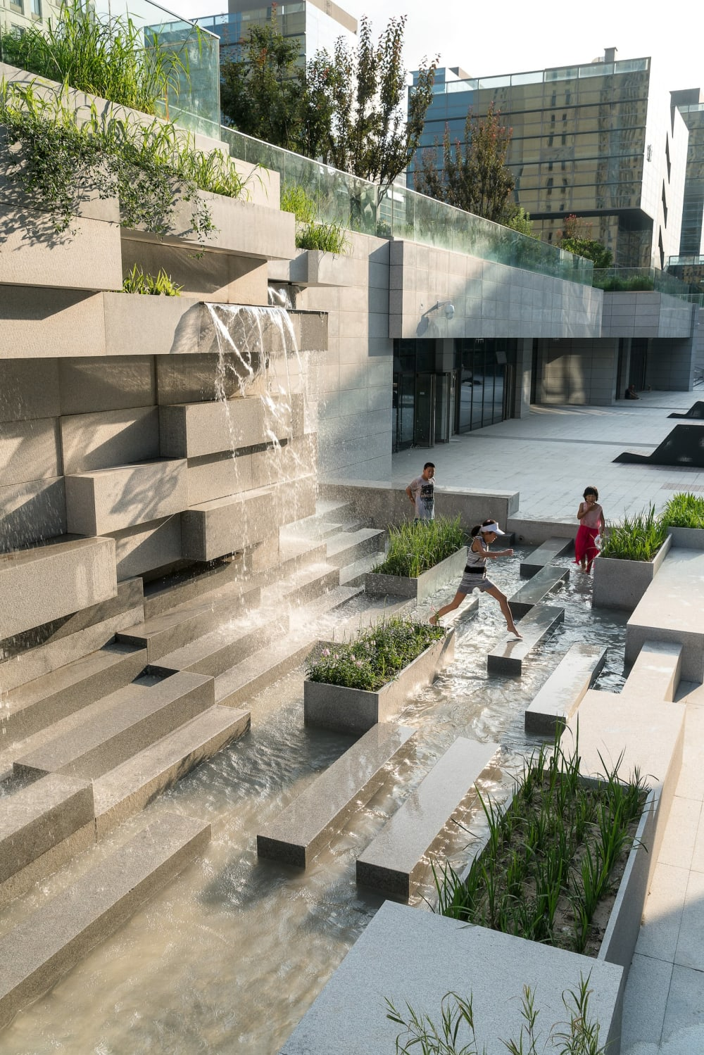 "Water feature in a city invites children to play.<span class=""sr-only""> (opened in a new window/tab)</span>"