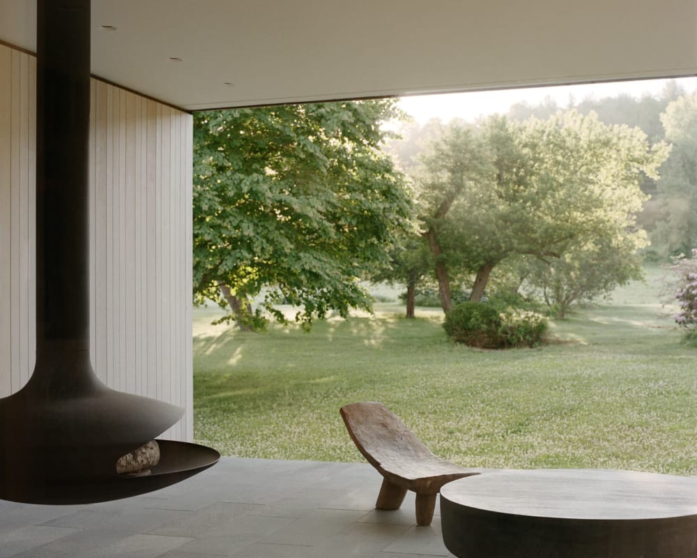 "Outdoor seating area overlooking a lush garden.<span class=""sr-only""> (opened in a new window/tab)</span>"