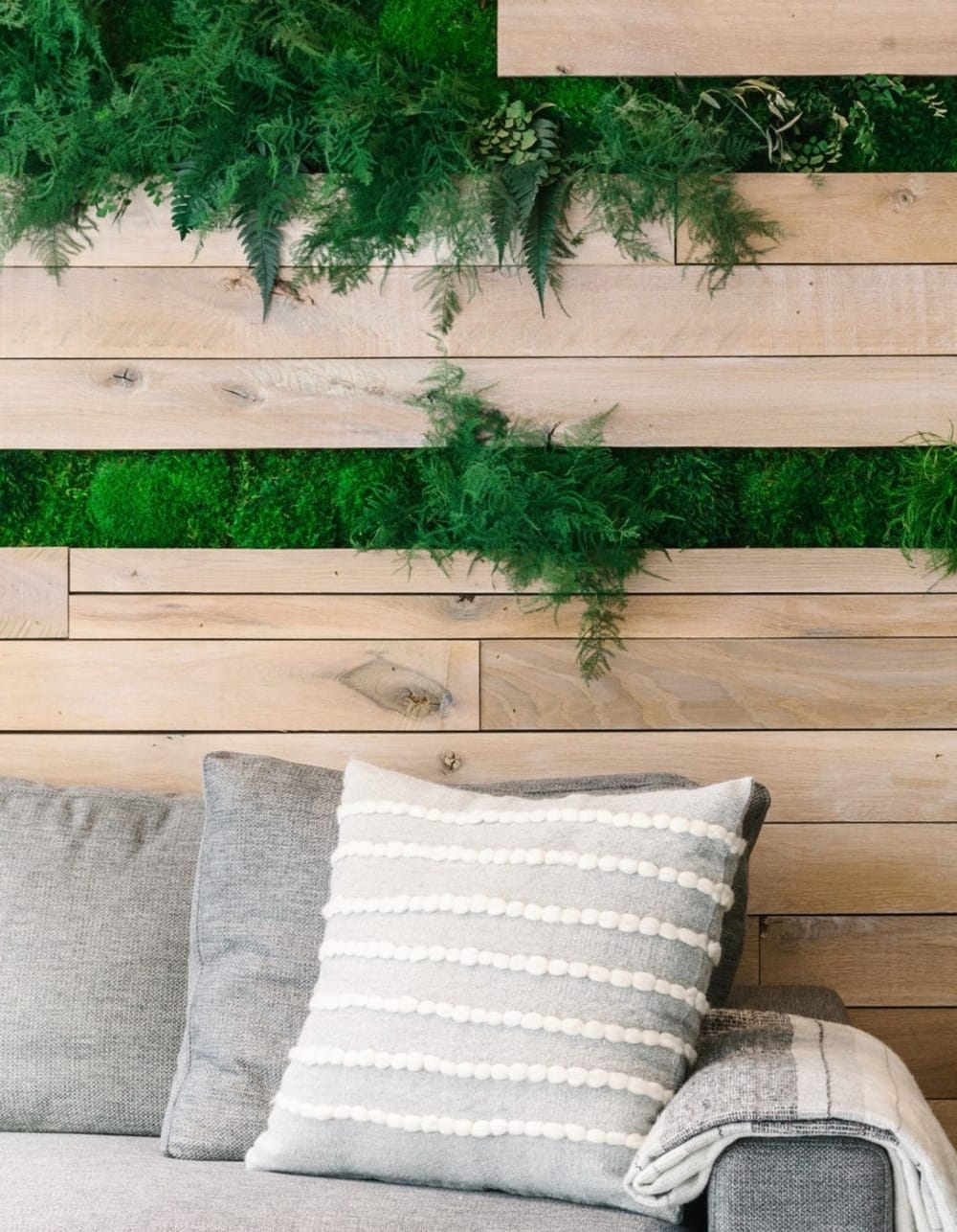 """Wood wall with greenery insets.<span class=""""sr-only""""> (opened in a new window/tab)</span>"""