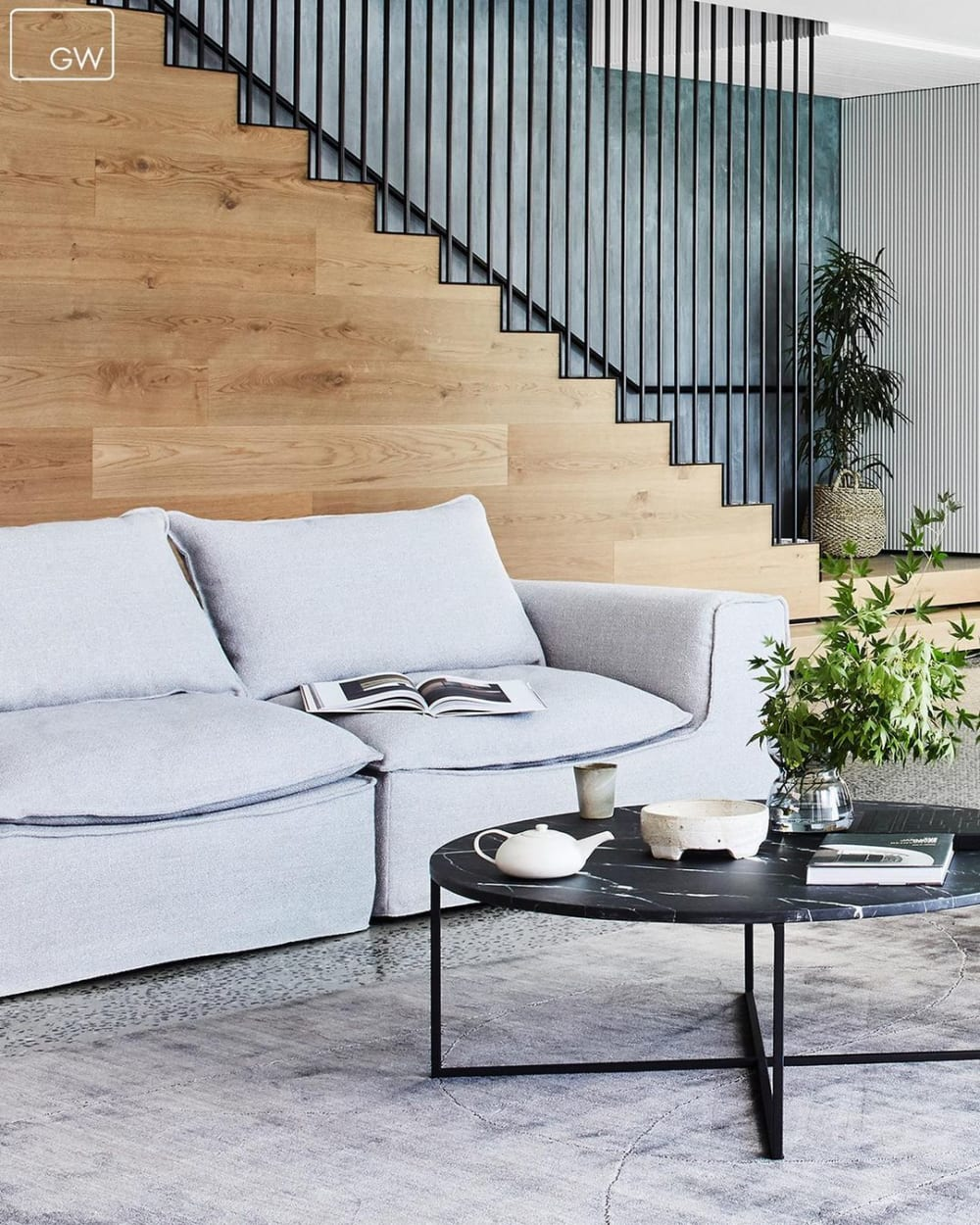 """Soft sofa in a bright living room with wooden back wall.<span class=""""sr-only""""> (opened in a new window/tab)</span>"""