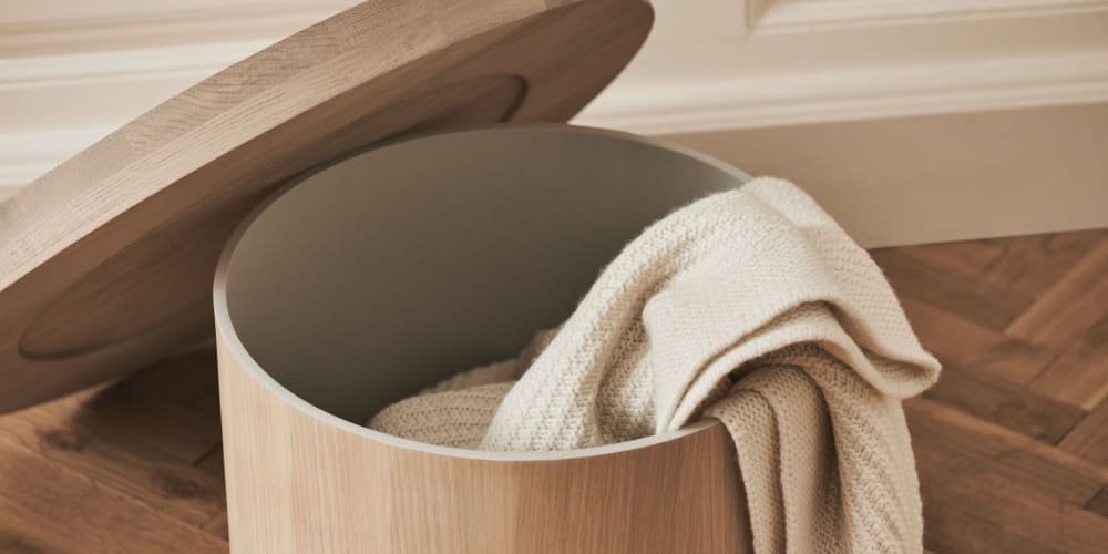 """Wooden side table with hidden storage containing a blanket.<span class=""""sr-only""""> (opened in a new window/tab)</span>"""
