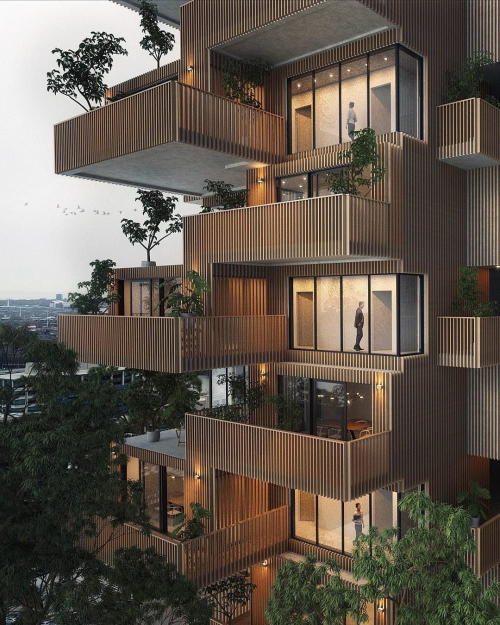 """Block of flats made of wood timber with plants on each balcony.<span class=""""sr-only""""> (opened in a new window/tab)</span>"""