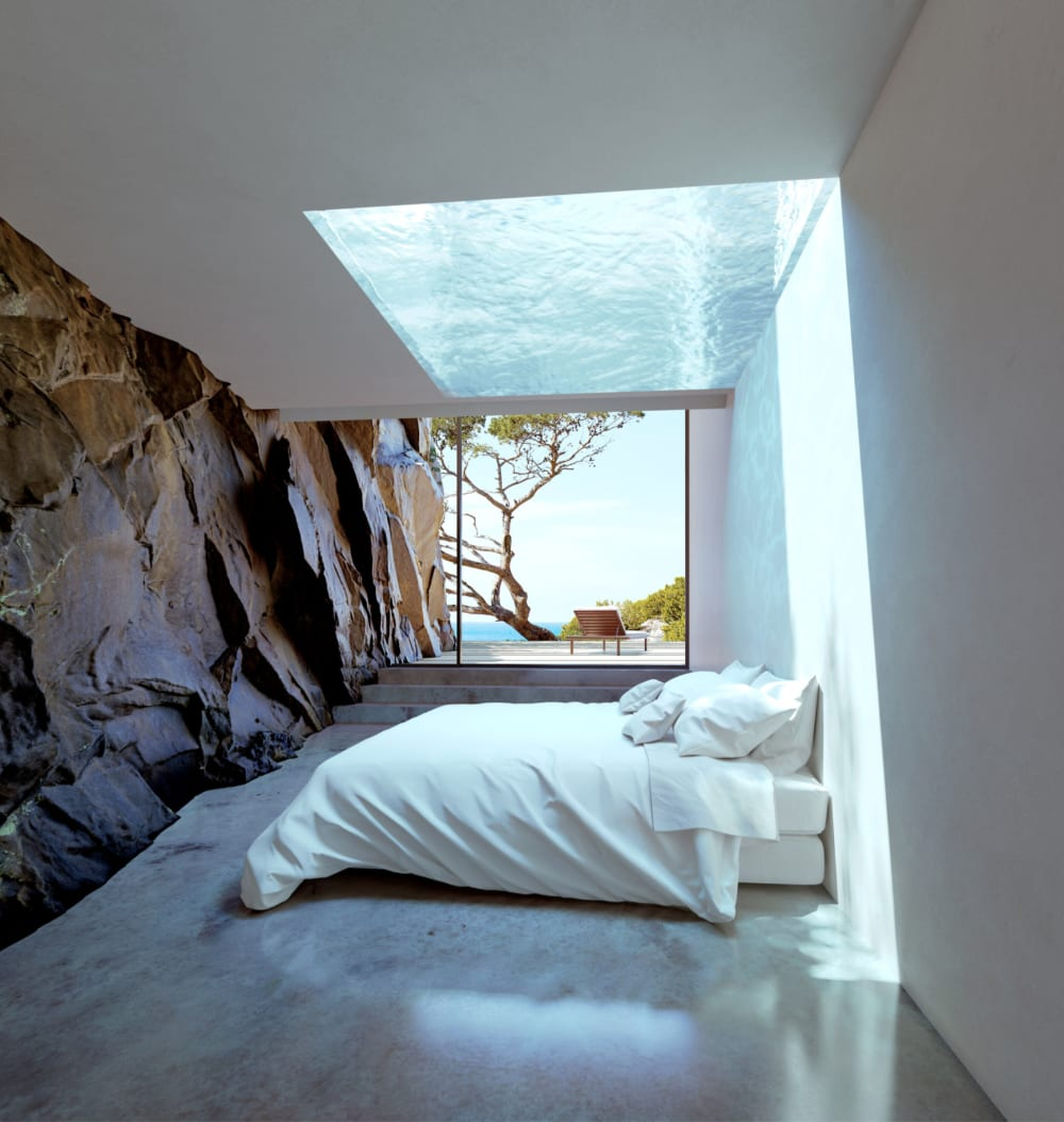 """Contemporary bedroom whose wall is the continuation of the rocky wall from outside.<span class=""""sr-only""""> (opened in a new window/tab)</span>"""