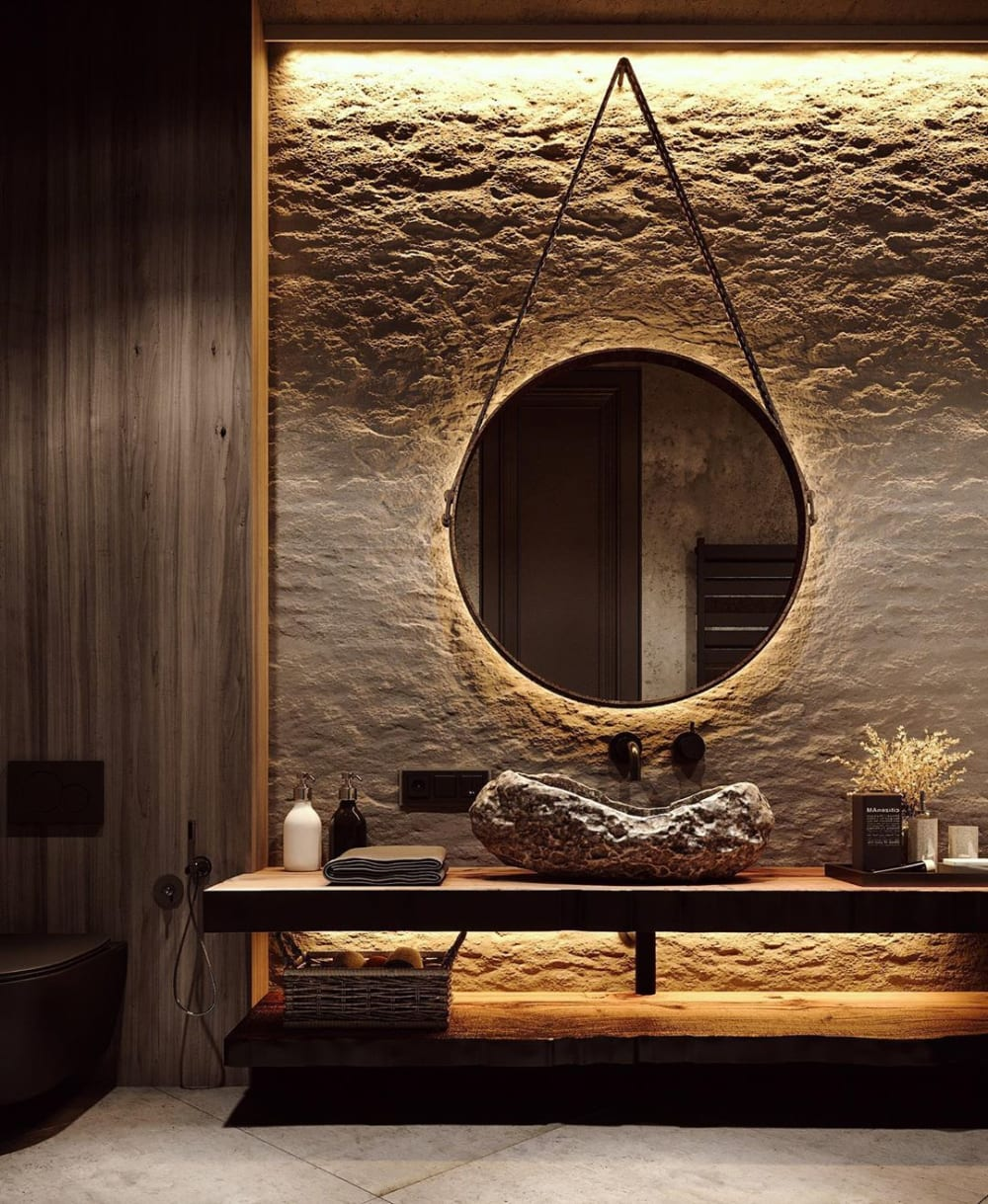 """Contemporary bathroom with a dazzling stone wall and a stone sink.<span class=""""sr-only""""> (opened in a new window/tab)</span>"""