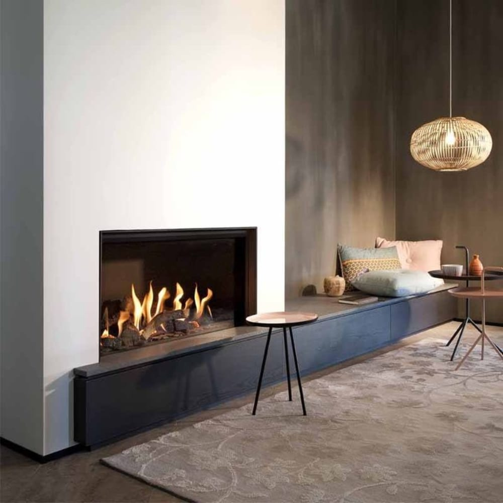 """Contemporary living room with a crackling fireplace.<span class=""""sr-only""""> (opened in a new window/tab)</span>"""