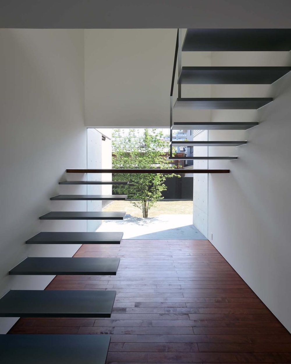 """A floating staircase with no railing.<span class=""""sr-only""""> (opened in a new window/tab)</span>"""