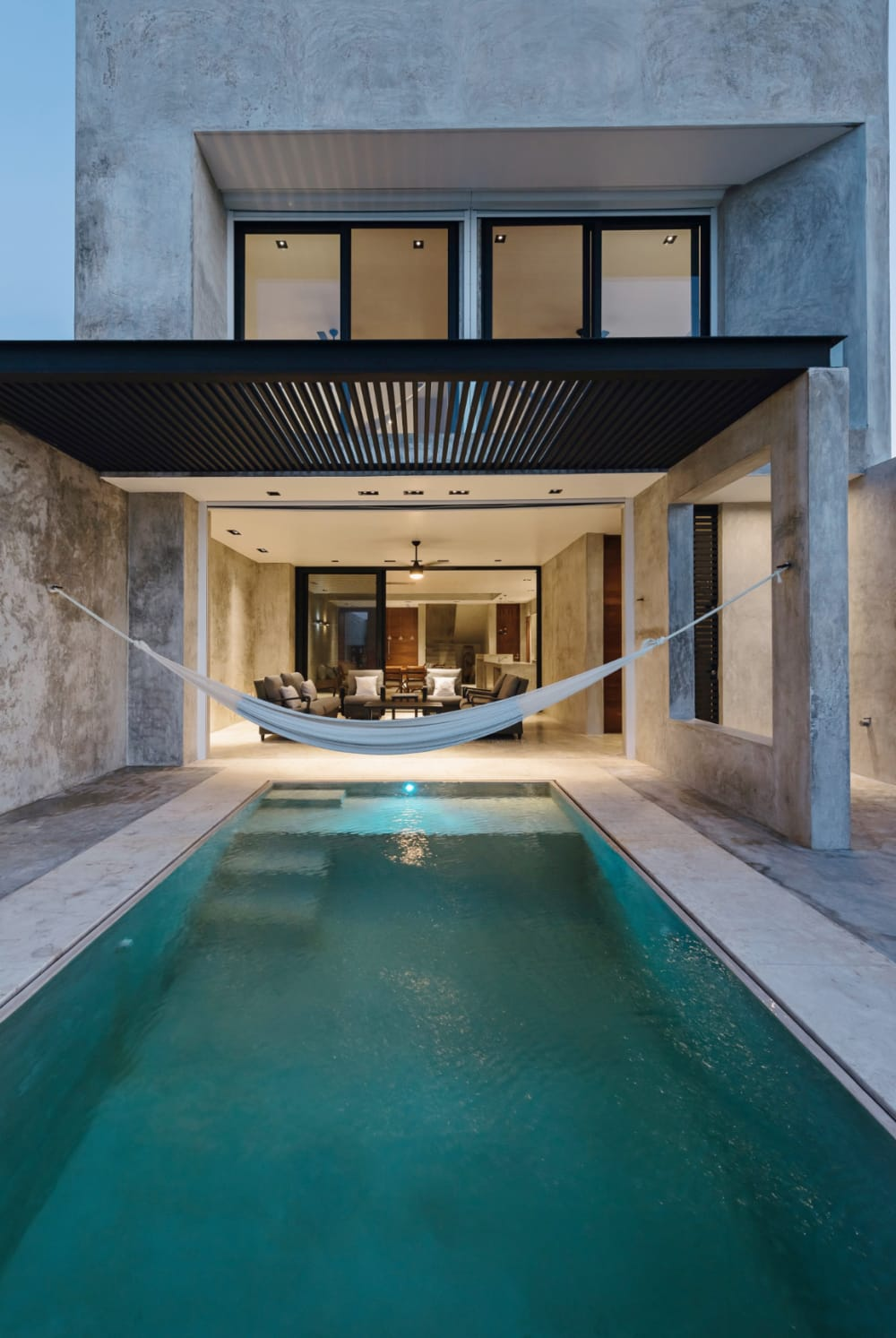 """Hammock hanging over a pool.<span class=""""sr-only""""> (opened in a new window/tab)</span>"""