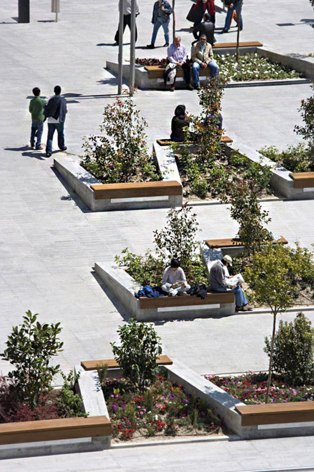 "Public space with planters and seating defining a path and creating distance between people.<span class=""sr-only""> (opened in a new window/tab)</span>"