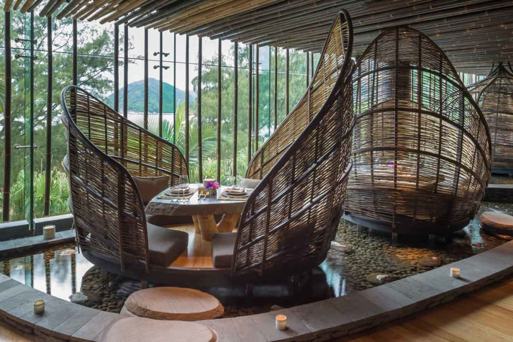 "Restaurant table enclosed in a rattan shell.<span class=""sr-only""> (opened in a new window/tab)</span>"