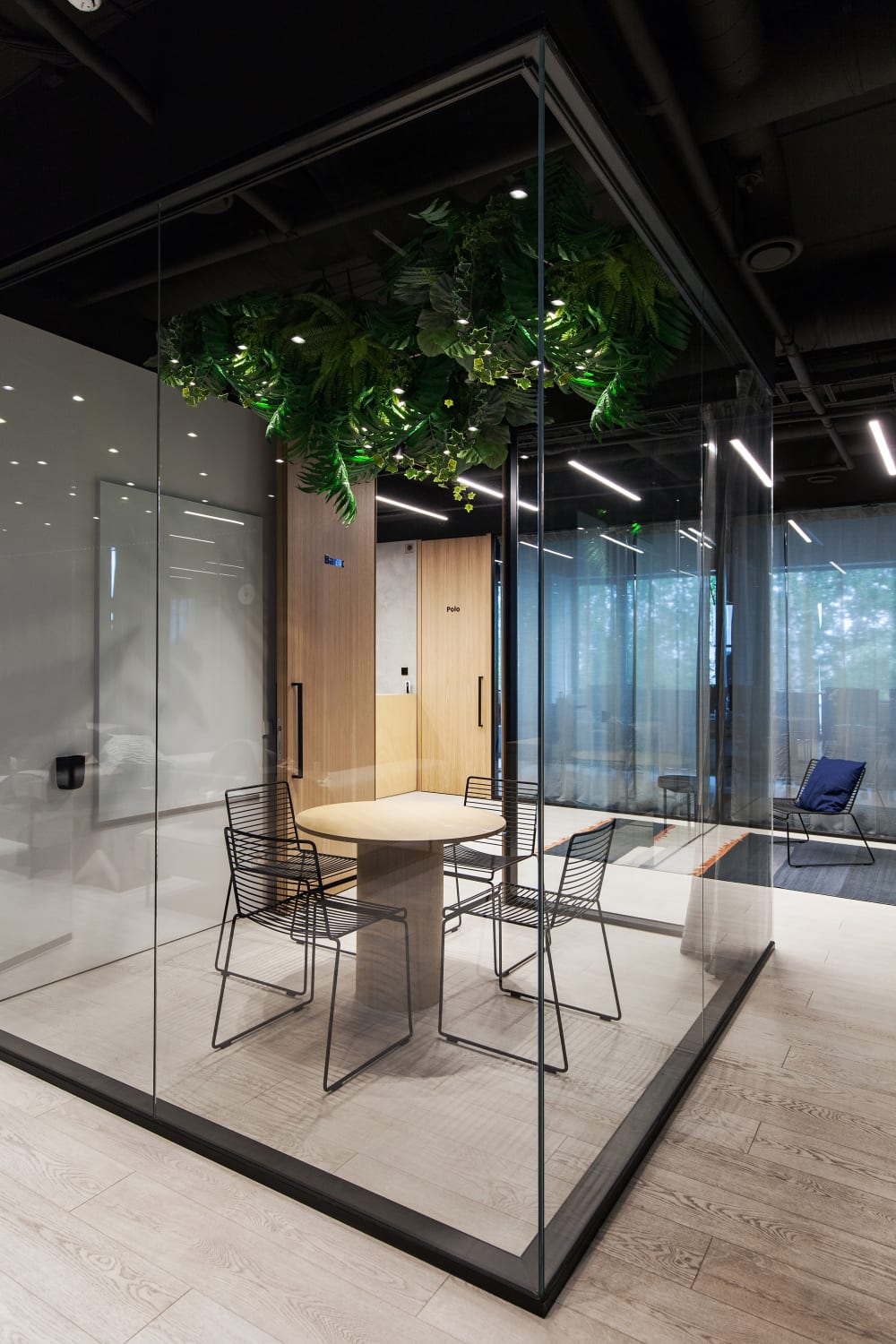 "Small meeting room with glass walls and plants hanging from the ceiling.<span class=""sr-only""> (opened in a new window/tab)</span>"