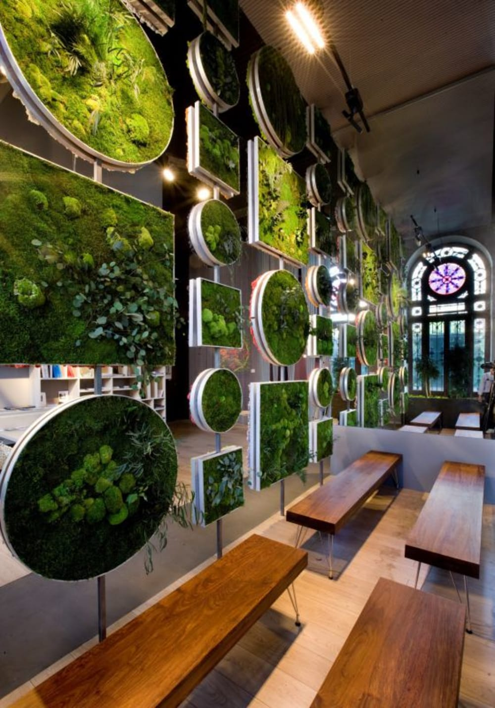 """Floor-to-ceiling room divider made with frames filled with moss.<span class=""""sr-only""""> (opened in a new window/tab)</span>"""