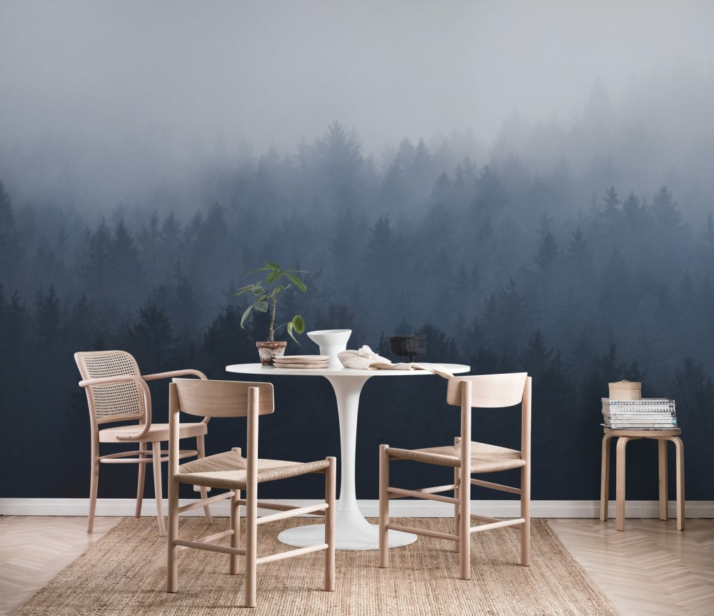 "Dining room with light wood furniture and a blue mural showing a foggy forest.<span class=""sr-only""> (opened in a new window/tab)</span>"