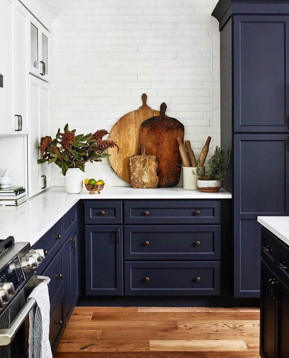 "Kitchen with blue cabinets, and rustic wood cutting boards and flowers as decor.<span class=""sr-only""> (opened in a new window/tab)</span>"