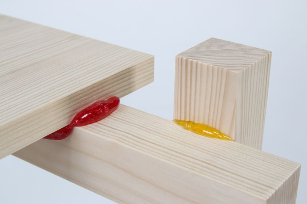 "Close up of the wooden pieces kept together with a candy-based glue.<span class=""sr-only""> (opened in a new window/tab)</span>"