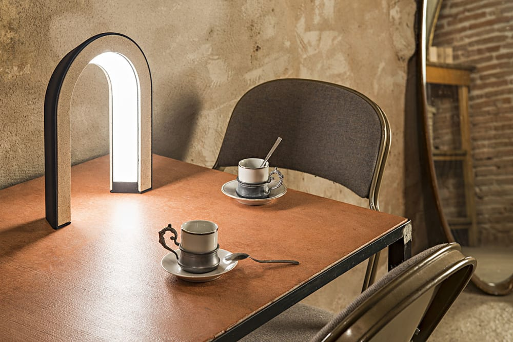 "Arc-shaped lamp made with coffee grounds, sitting on a table.<span class=""sr-only""> (opened in a new window/tab)</span>"