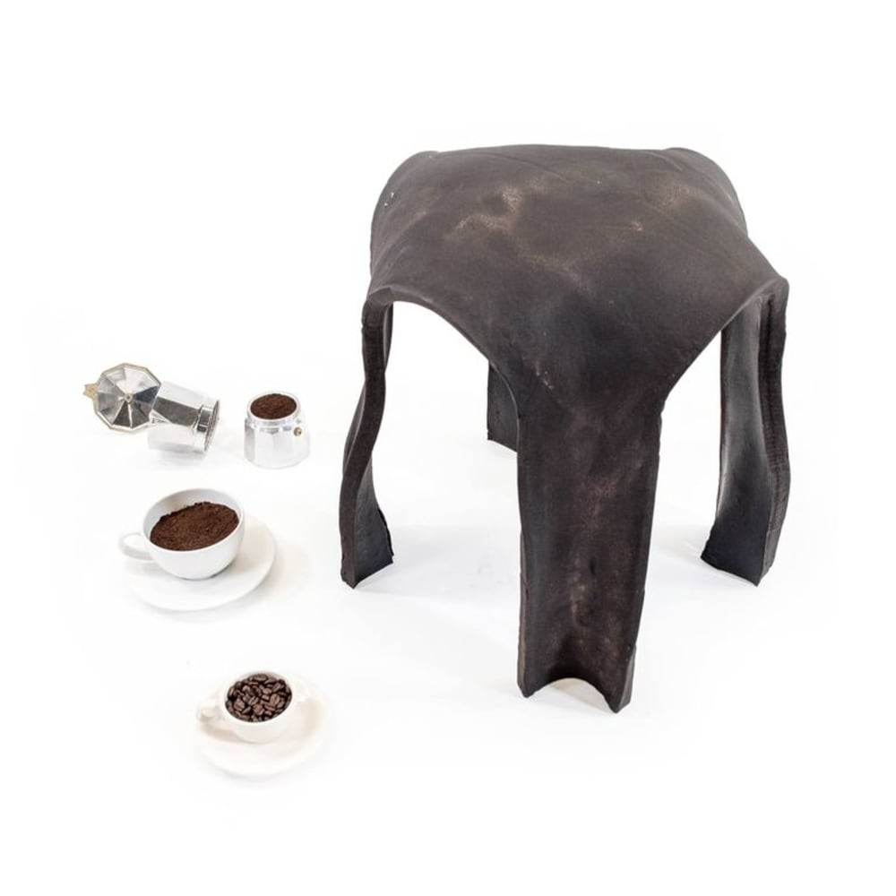 "Circular stool made out of coffee grounds.<span class=""sr-only""> (opened in a new window/tab)</span>"