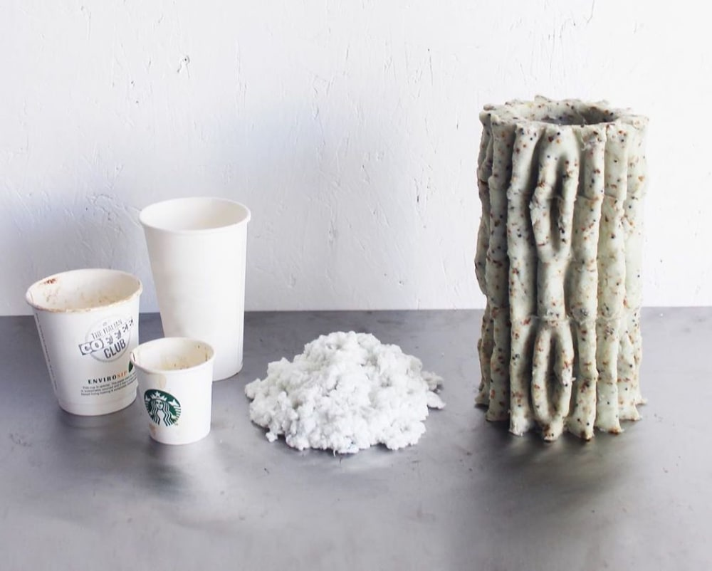"""Trashed coffee cups next to a mycelium based vase.<span class=""""sr-only""""> (opened in a new window/tab)</span>"""