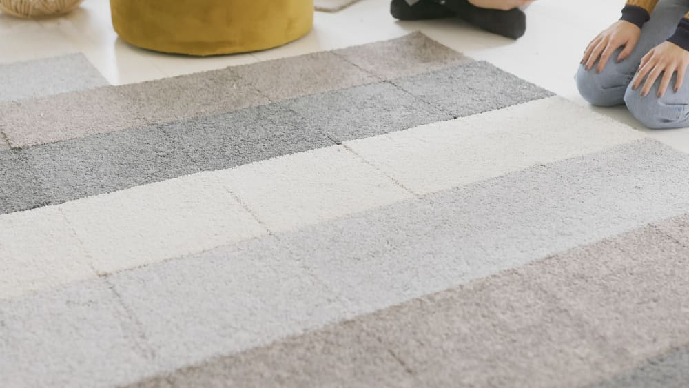 """Close up view of the modular rug tiles.<span class=""""sr-only""""> (opened in a new window/tab)</span>"""