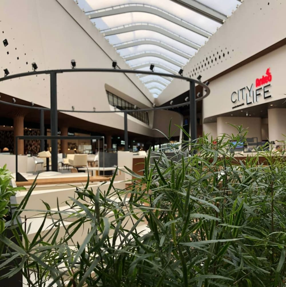 "Indoor view of CityLife shopping district, an example of biophilic design.<span class=""sr-only""> (opened in a new window/tab)</span>"