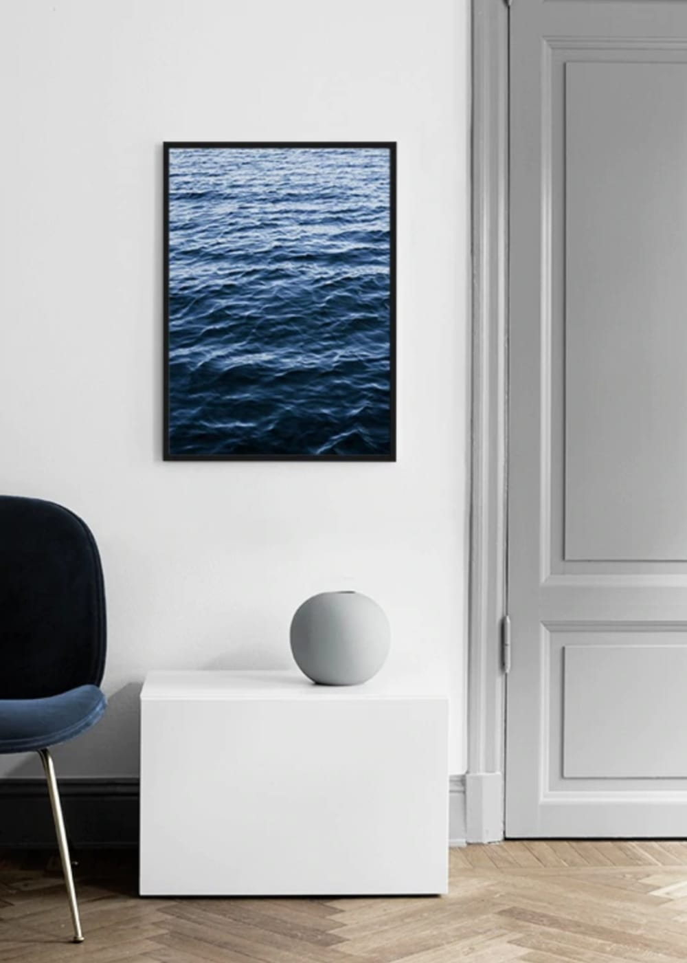 "Artwork representing the texture of water on a white wall surrounded by minimal furnishings.<span class=""sr-only""> (opened in a new window/tab)</span>"