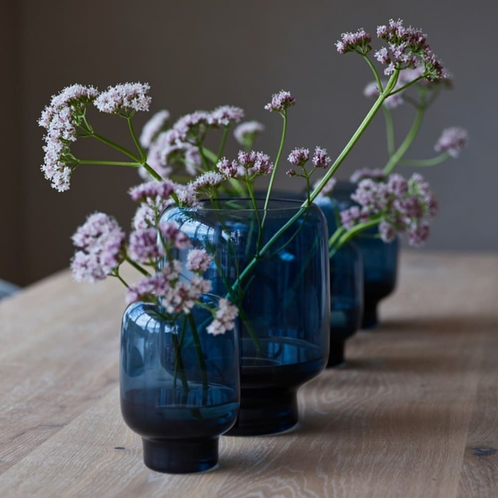 "Close-up of lilac flowers in blue vases.<span class=""sr-only""> (opened in a new window/tab)</span>"