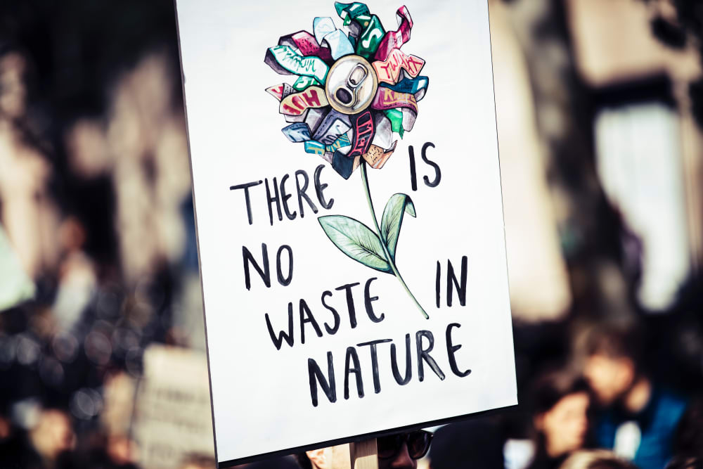 "Climate change sign saying ""There is no waste in nature"".<span class=""sr-only""> (opened in a new window/tab)</span>"