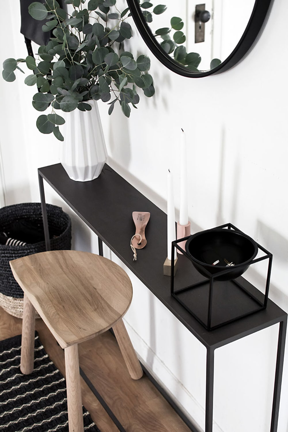 """Top-down shot of an entryway console fully equipped with a stool, baskets and catchalls.<span class=""""sr-only""""> (opened in a new window/tab)</span>"""