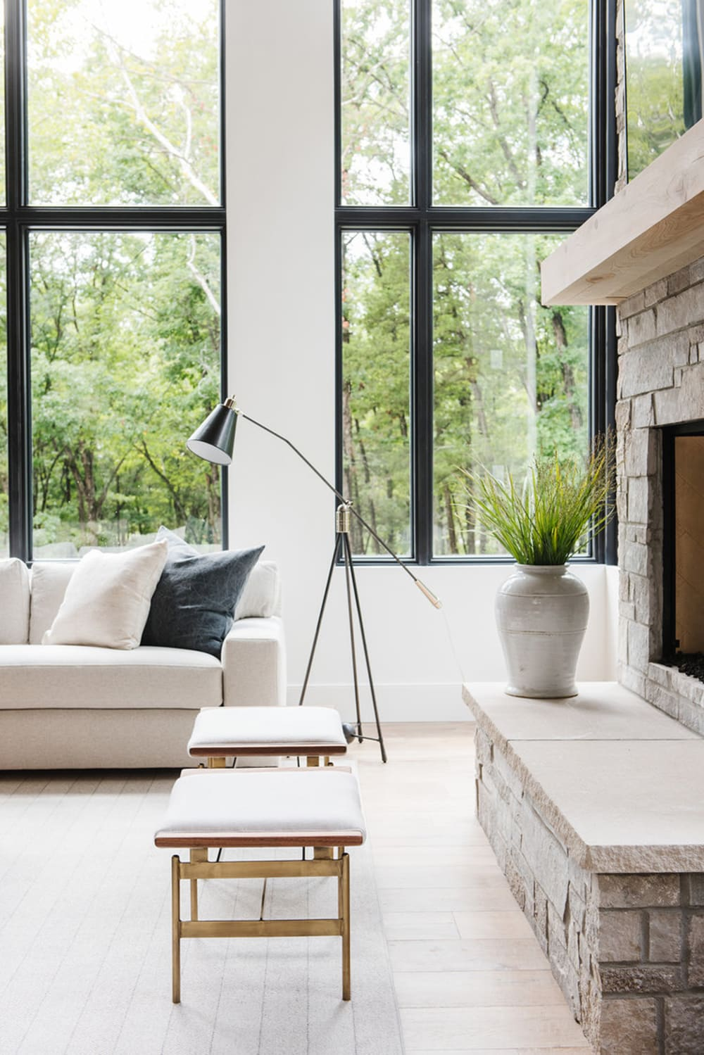 """Relaxing sofa with a huge window behind with a view on nature.<span class=""""sr-only""""> (opened in a new window/tab)</span>"""
