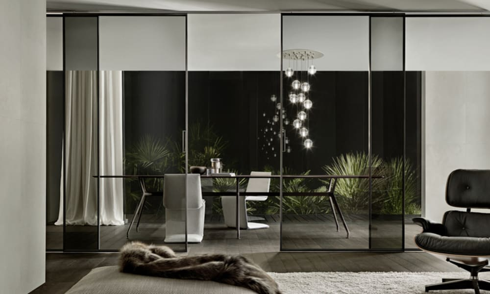 """Glass partition between living and dining room, great example of biophilic design.<span class=""""sr-only""""> (opened in a new window/tab)</span>"""