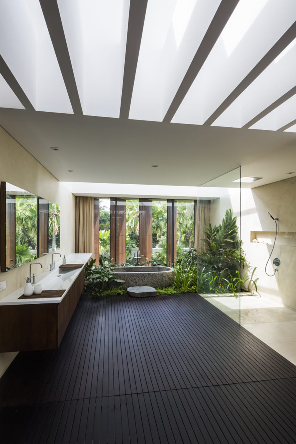 """Bathroom facing a huge window with plenty of plants down the bathtub.<span class=""""sr-only""""> (opened in a new window/tab)</span>"""
