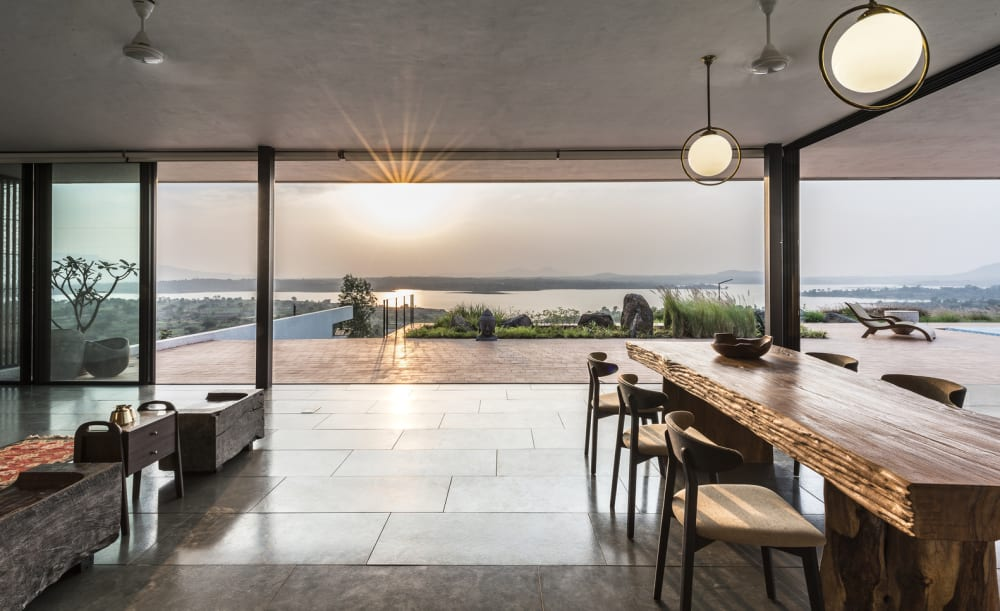 """Indoor-outdoor space at sunset.<span class=""""sr-only""""> (opened in a new window/tab)</span>"""