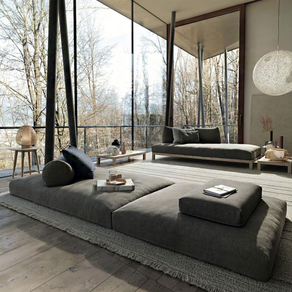 """Contemporary living room with full-height windows looking into a forest.<span class=""""sr-only""""> (opened in a new window/tab)</span>"""