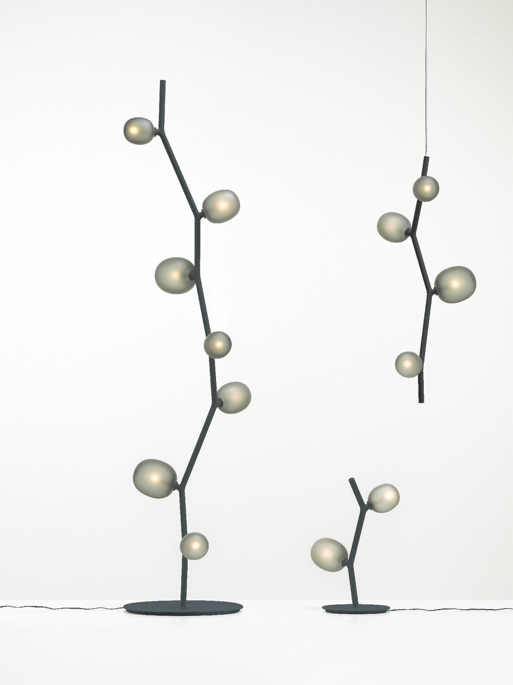 "Floor lamp recalling the shape of a branch (the structure) with leaves (the bulbs).<span class=""sr-only""> (opened in a new window/tab)</span>"